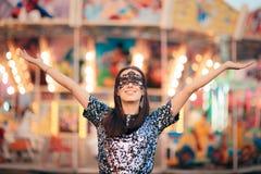 Woman Wearing carnival Mask at Funfair Amusement Park Stock Photo