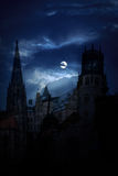 Mysterious medieval castle and the cathedral church at night. On a background of the full moon stock photos