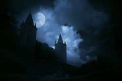 Mysterious medieval castle. In a misty full moon. Added some digital noise stock photo