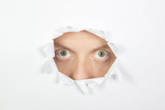 Mysterious men look through the hole. Stock Photography