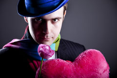 Mysterious men with toy and rose Stock Photo