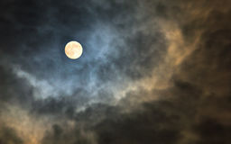 Mysterious midnight cloudy sky with full moon and moonlit clouds. Mysterious midnight cloudy sky with full moon and backlit moonlight storm clouds Stock Photos