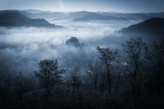 Mysterious misty morning over Biertan village, Transylvania, Romania. Stock Image