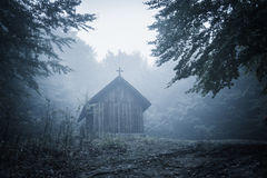 Mysterious misty morning over Biertan village, Transylvania, Romania. Stock Photos