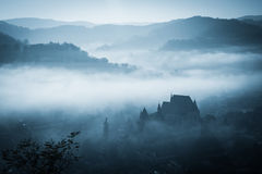 Mysterious misty morning over Biertan village, Transylvania, Romania Stock Photography