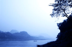 Mysterious morning landscape with mountains and river Mekong Royalty Free Stock Image