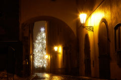 Mysterious narrow alley with christmas tree. In Prague Royalty Free Stock Image