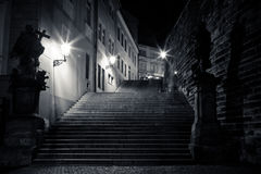Mysterious narrow alley with lanterns. In Prague at night Stock Photo