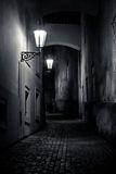 Mysterious narrow alley with lanterns. In Prague at night Stock Photography