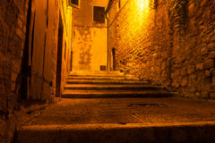 Mysterious narrow alley with lanterns, Italy Stock Photos
