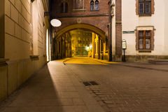 Mysterious narrow alley with lanterns in Krakow. At night Stock Photos
