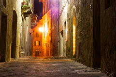 Mysterious narrow alley with lanterns Stock Photos