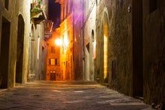 Mysterious narrow alley with lanterns Stock Photos