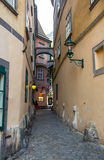 Mysterious narrow alley with lanterns in Prague at night.  Stock Images
