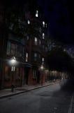 Mysterious Night Scence, Historic Boston Street. Night time scene of historic Boston Massachusetts street, light with street lamps and apartment windows Stock Photos