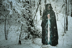 Mysterious old man with magical ice sword Stock Photo