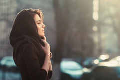 The mysterious pensive woman in a hood Royalty Free Stock Image