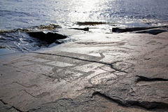 Mysterious petroglyphs of Onega. Besov Nos Stock Photo