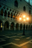 Mysterious plazza in the evening in Venice. Mysterious plazza arcade in the evening in Venice, a mysterious light give you a sign, will you follow it stock photos