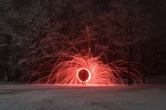 Mysterious portal to another dimension,. A human silhouette on a background winter landscape, crimson sparks royalty free stock photo