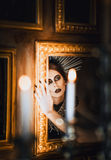 Mysterious portrait of beautiful goth girl looking into mirror Royalty Free Stock Photos