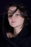Mysterious portrait of pretty young brunette. Mysterious portrait of a pretty young girl with a scarf Stock Photography