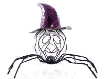 Mysterious pumpkin. An odd pumpkin wearing a purple hat with a big black spider isolated Stock Photos