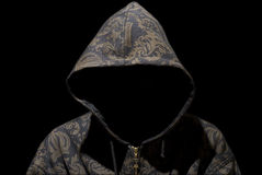 Hooded man on dark background Stock Photos