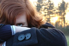 Mysterious redhead. A mysterious woman hiding from something Stock Images