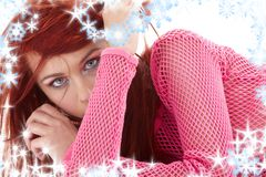 Mysterious redhead in pink fishnet Royalty Free Stock Photo