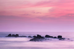 Mysterious rocks in the ocean on the horizon after Royalty Free Stock Photo