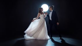 Mysterious and romantic meeting, the bride and groom under the moon. Hugs together. stock photo