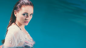 Mysterious seductive woman in water. Stock Images