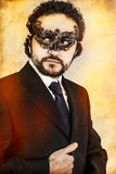 Mysterious sexy man with artistic style with  Venetian mask Stock Image