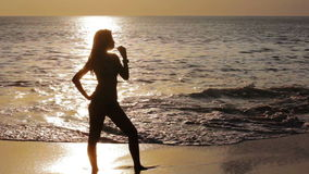 Mysterious silhouette sexy girl at beach during sunset stock video footage