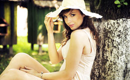 Mysterious smile of brunette young woman Royalty Free Stock Image