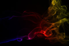 Mysterious smoke form with colour gradient. On a black background Royalty Free Stock Photography