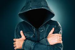 Mysterious suspicious faceless man with hoodie. Dark low key portrait for crime and violence concepts royalty free stock photos