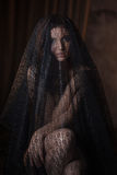 Mysterious tenderness portrait of beautiful woman in black lace veil Royalty Free Stock Images