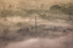 Mysterious Tower. This tower and the fog have created amazing picture Stock Images