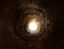 Mysterious tunnel to the light stock photo
