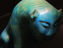 Mysterious turquoise feline sculpture Stock Photo