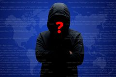 Mysterious unknown hacker in black clothing with hoodie, stands crossed hands against dark digital interface background with red q stock images