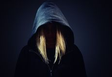 Mysterious, unknown woman  in hood. Royalty Free Stock Photography