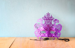 Mysterious Venetian masquerade mask on wooden table Royalty Free Stock Photo