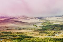 Mysterious view of the hills and canyons in a colorful tone. Mountain peaks in the fog, pastel color royalty free stock photos