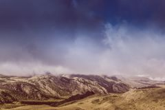 Mysterious view of the hills and canyons in a colorful tone. Mountain peaks in the fog, pastel color stock images