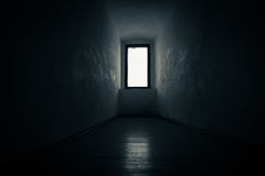Mysterious window to nowhere. Mysterious window lit with white light leading to nowhere stock photography
