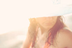 Mysterious woman. Woman in the blinding rays of sunlight Royalty Free Stock Photo