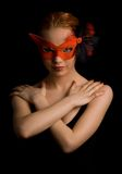 Mysterious Woman. Mysterious lady in red mask holding her arms in w shape Royalty Free Stock Photography
